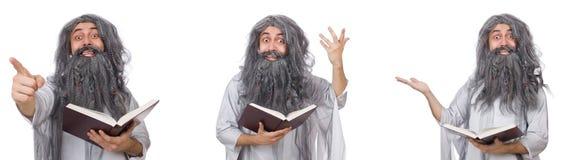 有书的滑稽的老巫术师 库存照片
