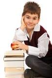 有书的聪明的学员男孩 免版税库存照片