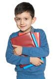 有书的聪明的年轻男孩 库存图片