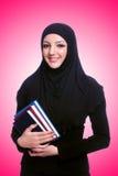 有书的年轻回教妇女在白色 免版税库存照片