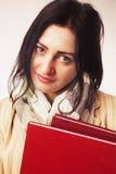 有书& x28的年轻学生女孩; 教育和自我发展& x29; 免版税库存图片
