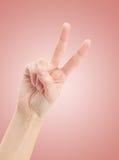 有二个手指的现有量在和平或胜利符号。 免版税库存照片