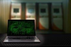 有二进制编码的计算机从显示器有自动出纳机迷离背景 免版税库存照片