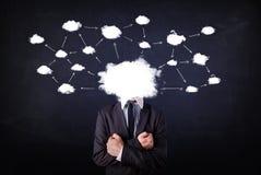 有云彩网络头的商人 免版税库存图片