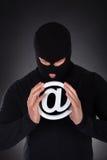 有互联网领域标志的黑客 库存照片