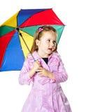 有五颜六色的伞的逗人喜爱的小女孩 免版税图库摄影