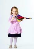 有五颜六色的伞的逗人喜爱的小女孩 库存图片
