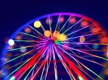 有五颜六色的光的Defocused弗累斯大转轮 库存照片