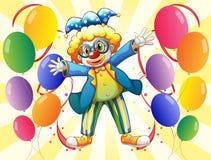 有五颜六色的党气球的一个小丑 库存图片