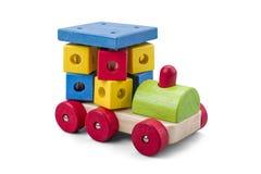有五颜六色的块的木车的卡车玩具被隔绝在与裁减路线的白色 库存图片