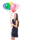 有五颜六色的气球的愉快的妇女 免版税库存图片