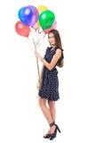 有五颜六色的气球的美丽的妇女 免版税库存照片
