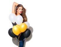 有五颜六色的气球的美丽的时装模特儿女孩 库存照片