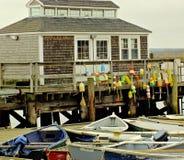 有五颜六色的浮体的渔船坞 库存图片