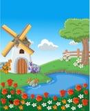 有五颜六色的美丽的春天花的绿色庭院 免版税库存照片