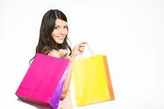 有五颜六色的袋子的愉快的妇女顾客 免版税库存照片