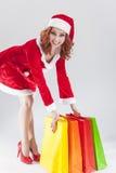 有五颜六色的S的愉快的微笑的白种人姜圣诞老人帮手女孩 免版税库存图片