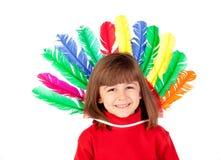 有五颜六色羽毛的微笑的孩子 库存照片