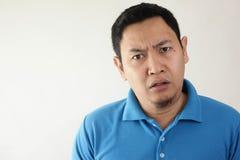 有亚裔的人怀疑和不满意的或者不信任表示 免版税库存图片