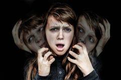 有人格分裂的妇女遭受精神分裂症 库存照片