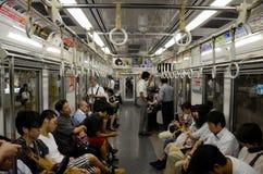 有人的地下地铁地铁支架在东京日本 免版税库存图片
