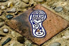 有人脚的反射, a的元素的陶瓷砖 免版税库存照片