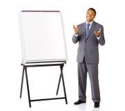 有介绍画架的销售人员 免版税库存图片