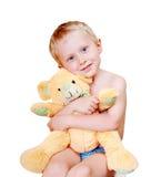 有他的爱玩具的微笑的小男孩 库存图片