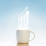 有企业标志的咖啡杯 免版税库存图片