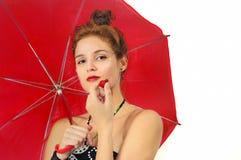 有伞和草莓的女孩 免版税图库摄影