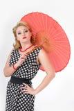 有伞图片的女孩仿照20世纪60年代样式 图库摄影