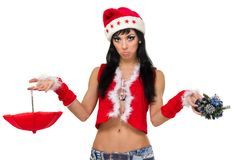 有伞的圣诞老人女孩和反对被隔绝的白色的圣诞树 图库摄影