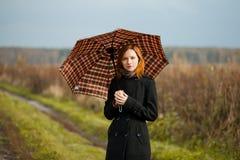 有伞的夫人 库存照片