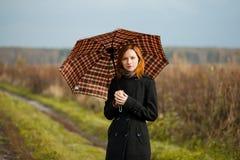 有伞的夫人 免版税库存照片
