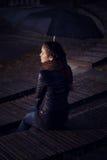 有伞的女孩在电影院 库存图片