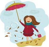有伞的女孩在雨中 免版税图库摄影