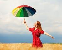 有伞的女孩 免版税图库摄影