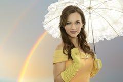 有伞的少妇 免版税图库摄影