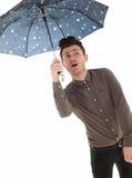 有伞的英俊的人 免版税图库摄影