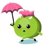 有伞的绿色妖怪在雨下 库存图片