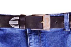有传送带的迷离牛仔裤 免版税库存照片