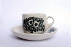 有传统图片的咖啡杯对此 免版税库存照片