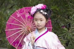 有传统garbe的中国女孩 免版税库存图片