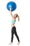 有体操球的运动的妇女 免版税库存图片