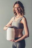 有体育营养的妇女 图库摄影