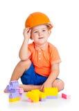 有使用与玩具的安全帽的儿童男孩 免版税库存照片