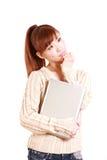 有便携式计算机的日本少妇考虑某事 免版税库存照片