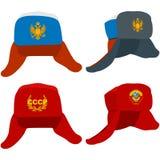 有俄国和苏联标志的Ushanka帽子 库存照片