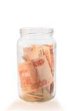 有俄国金钱的玻璃瓶子 库存照片