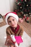 有信件的男孩圣诞老人的 库存照片